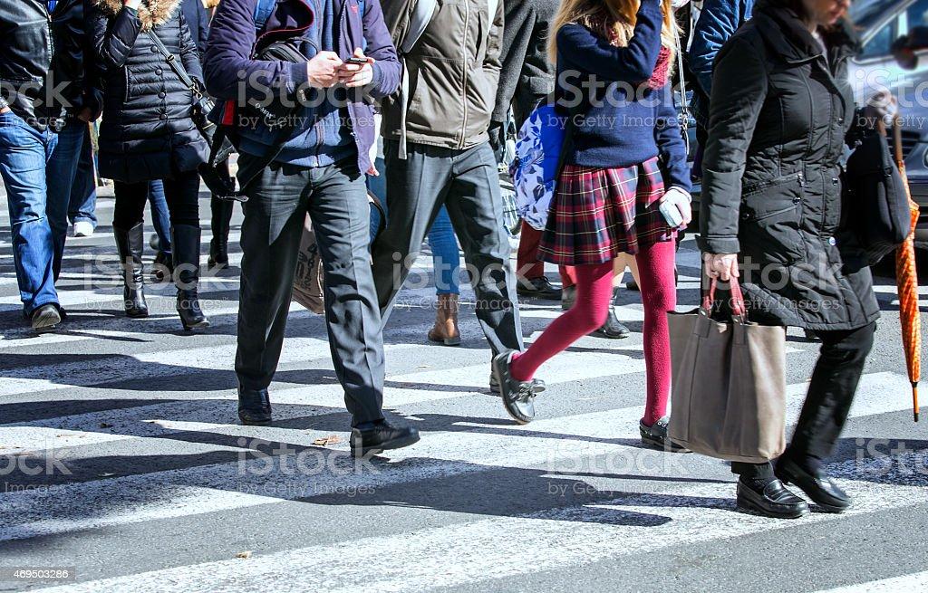 Pedestrians crossing a street stock photo