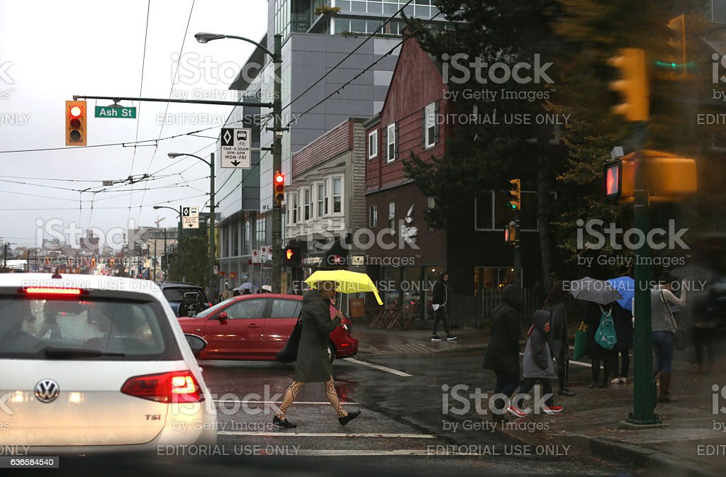 Pedestrians Crossing Intersection, West Broadway, Vancouver, Canada stock photo
