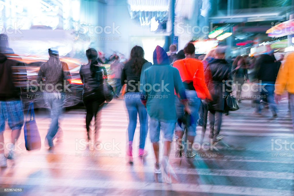 Pedestrians Crossing Street at Night, Blurred Motion Manhattan, New York stock photo