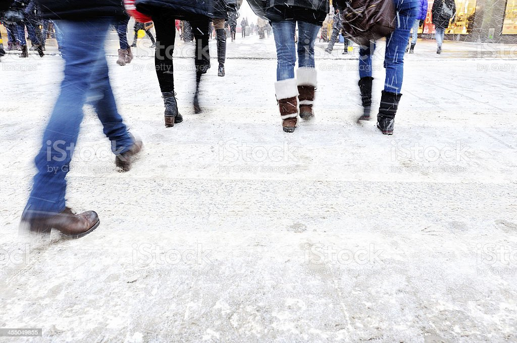 Pedestrians crossing street in the winter stock photo