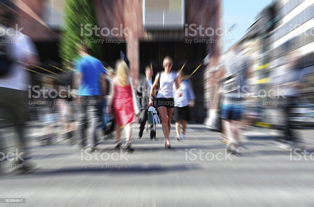 Pedestrians crossing street stock photo