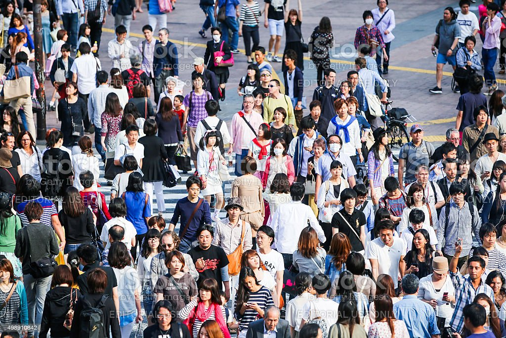 Pedestrians crossing the busiest crosswalk in the world stock photo
