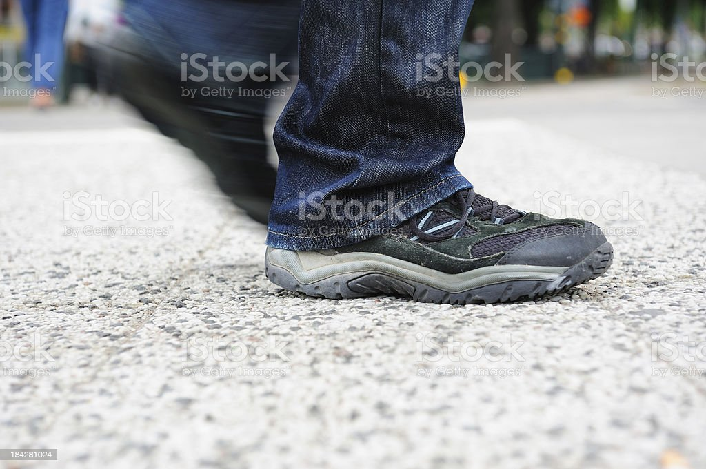 Pedestrians foot/shoe on tiled street stock photo