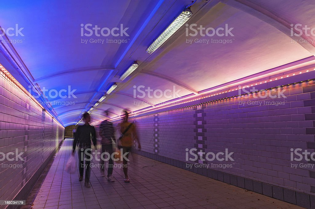 Pedestrians in colourful subway Singapore stock photo