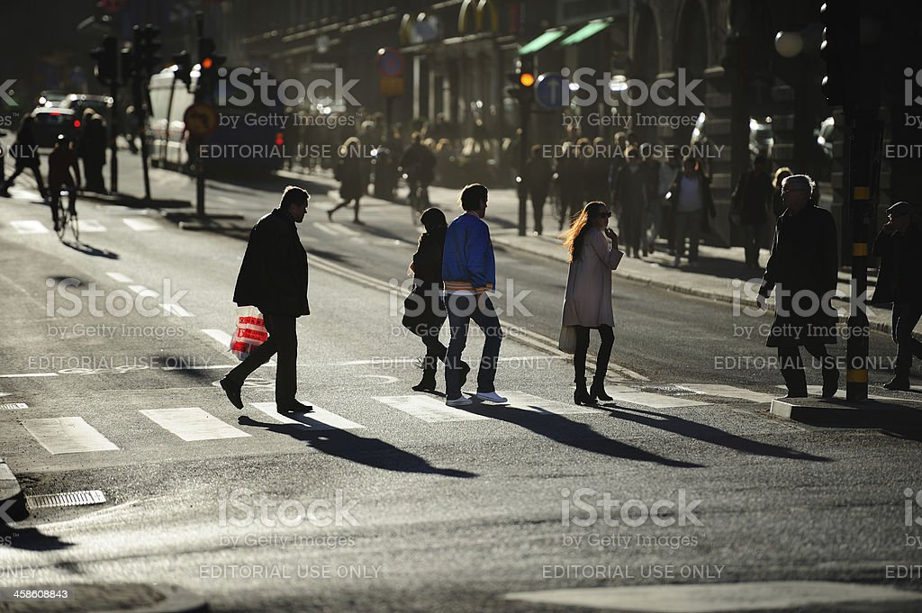 Pedestrians in silhouette crossing street royalty-free stock photo