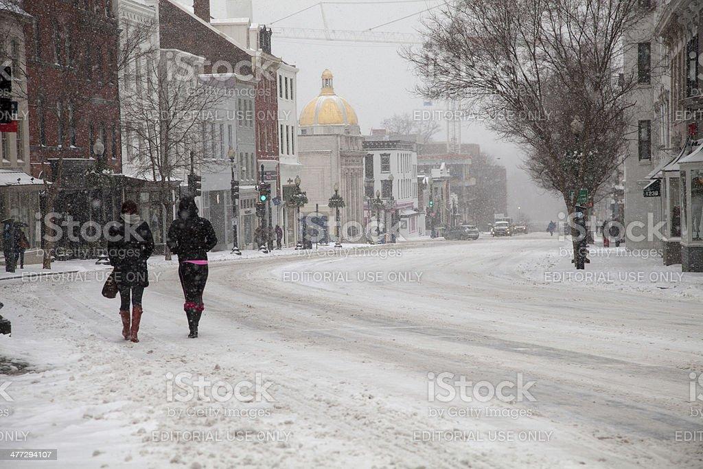Pedestrians in snow stock photo