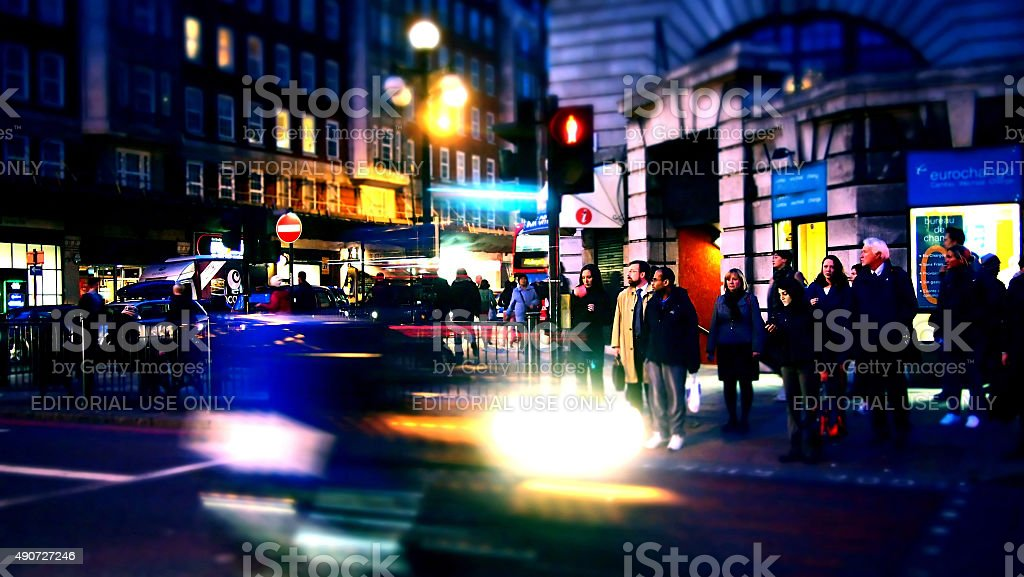 Pedestrians on Baker Street at Night stock photo