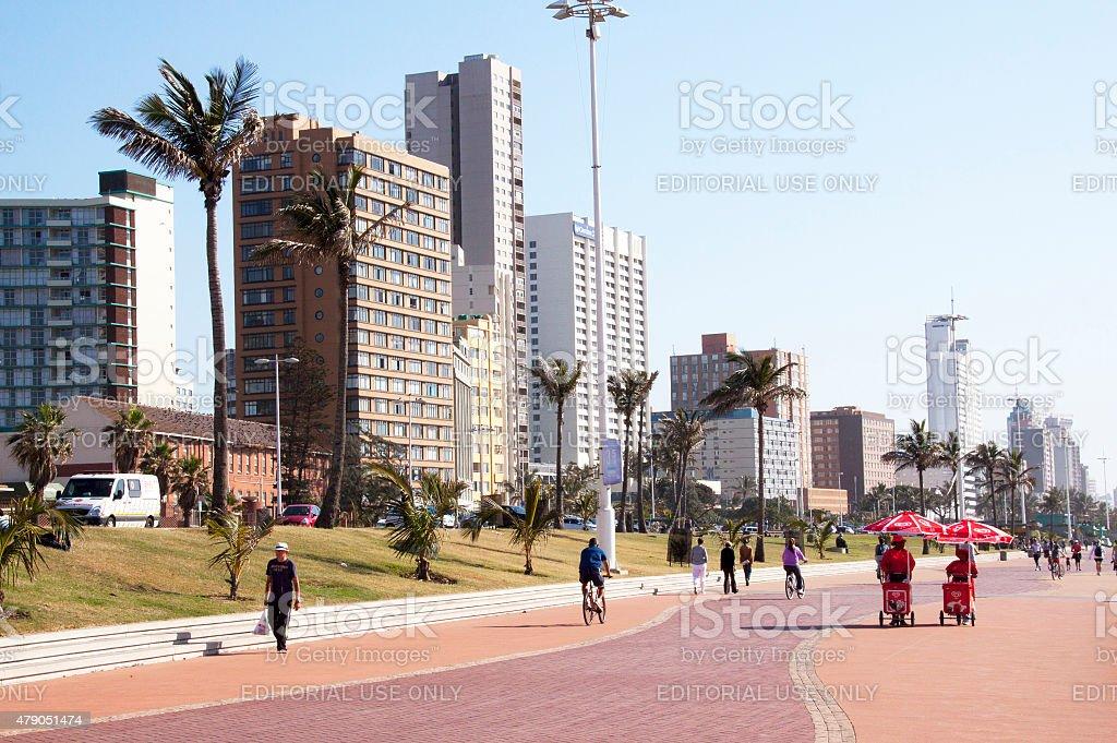Pedestrians on Paved Promenade on Durban Beach Front stock photo
