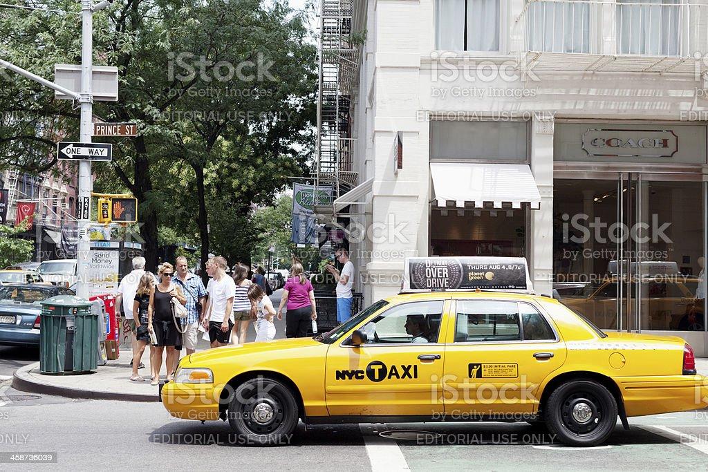 Pedestrians on Prince Street, NYC. stock photo