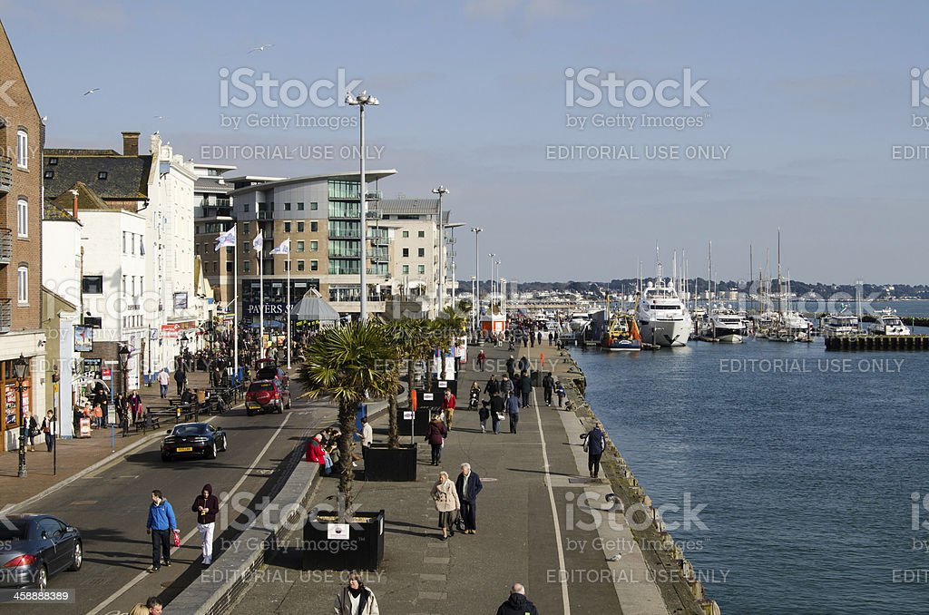 Pedestrians on Quayside, Poole Harbour stock photo