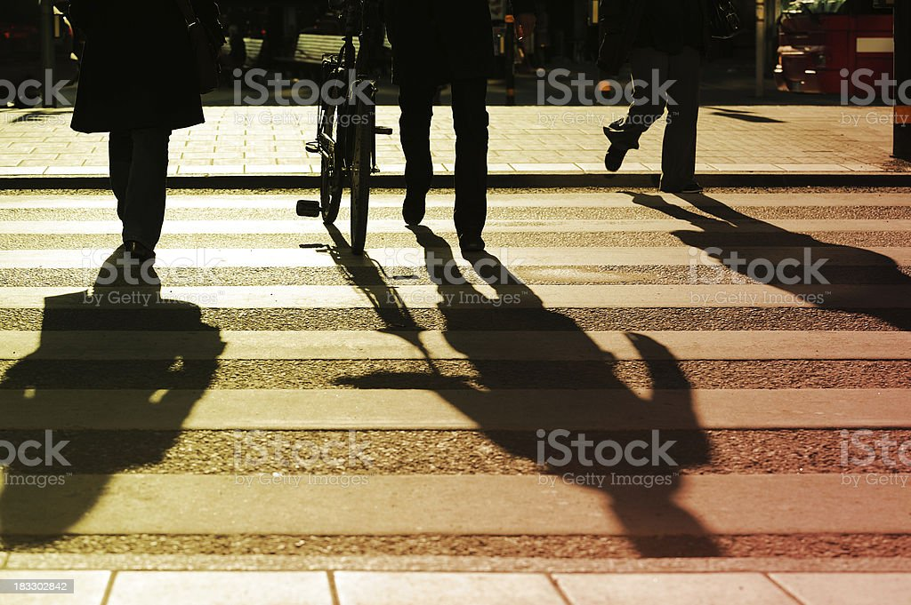 Pedestrians on zebra crossing in silhouette royalty-free stock photo