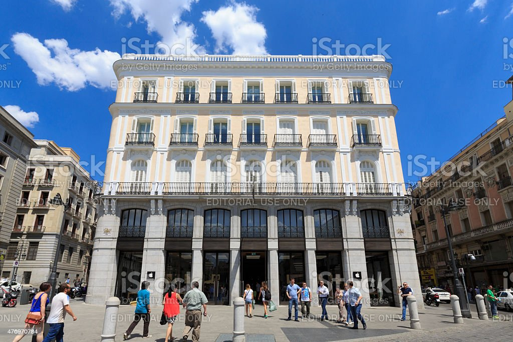Pedestrians outside the Apple Store in Madrid, Spain stock photo