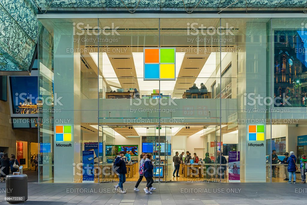 Pedestrians passing by Microsoft flagship store in Sydney stock photo