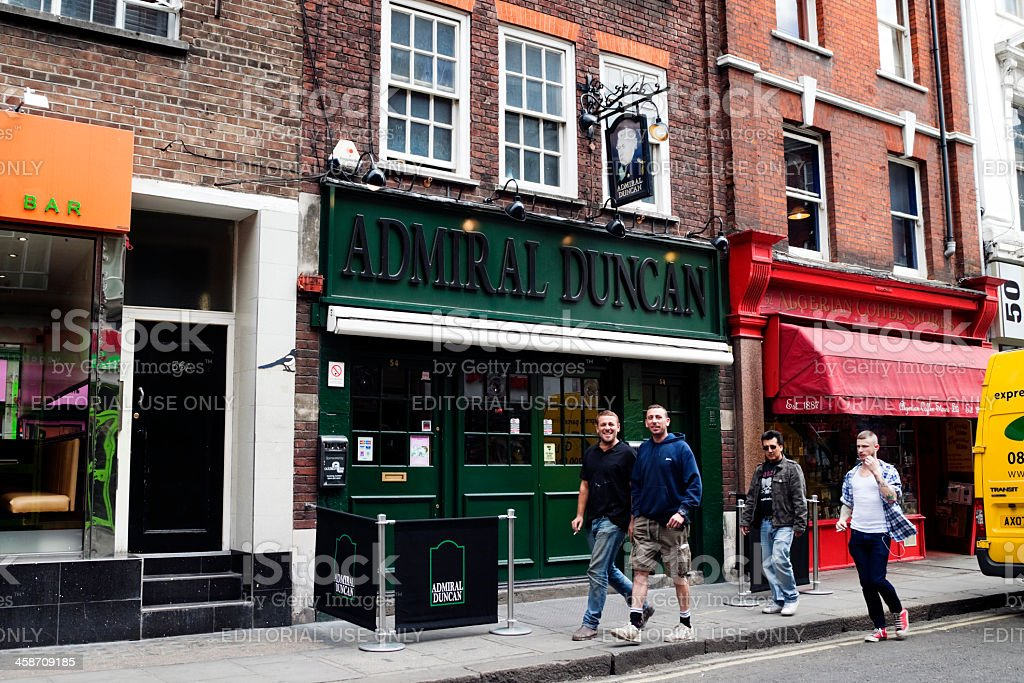 Pedestrians passing the Admiral Duncan pub, Soho royalty-free stock photo