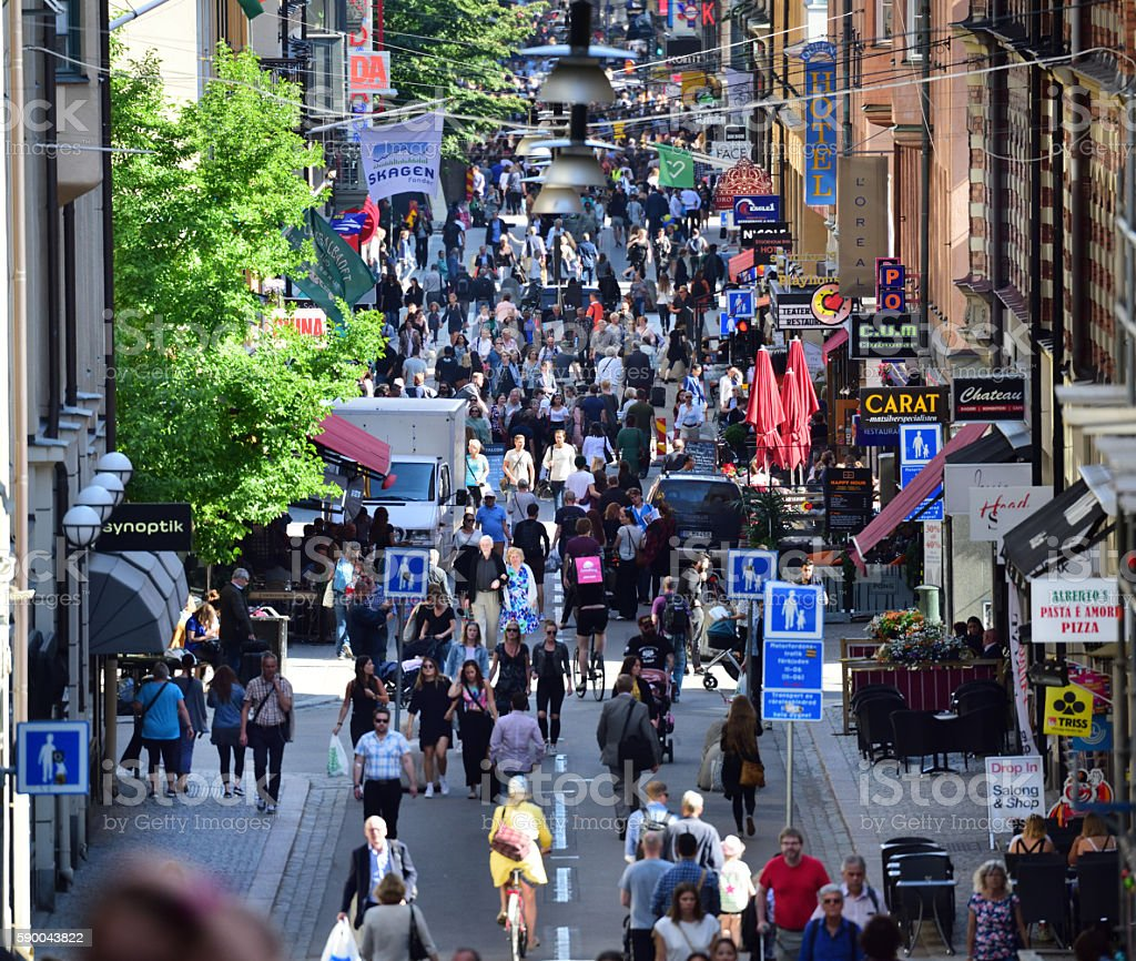 Pedestrians, tourists and shoppers on street stock photo
