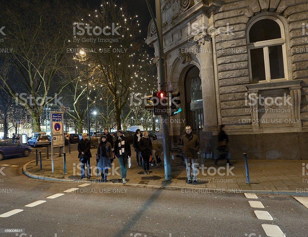 pedestrians waiting at zebra crossing in Dusseldorf Germany royalty-free stock photo
