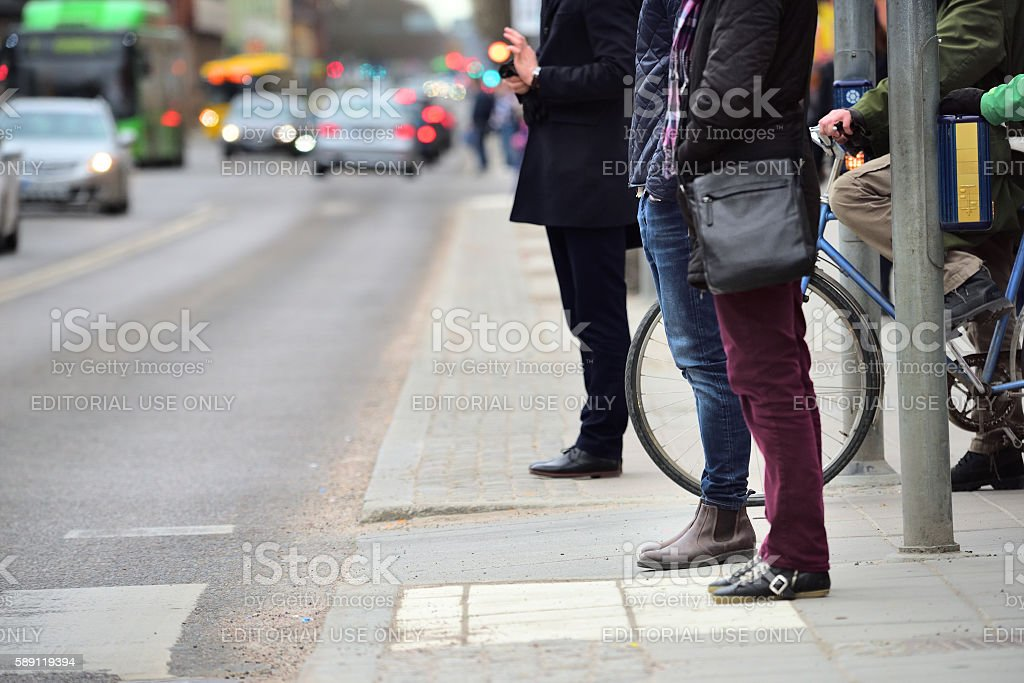 Pedestrians waiting, on zebra crossing stock photo