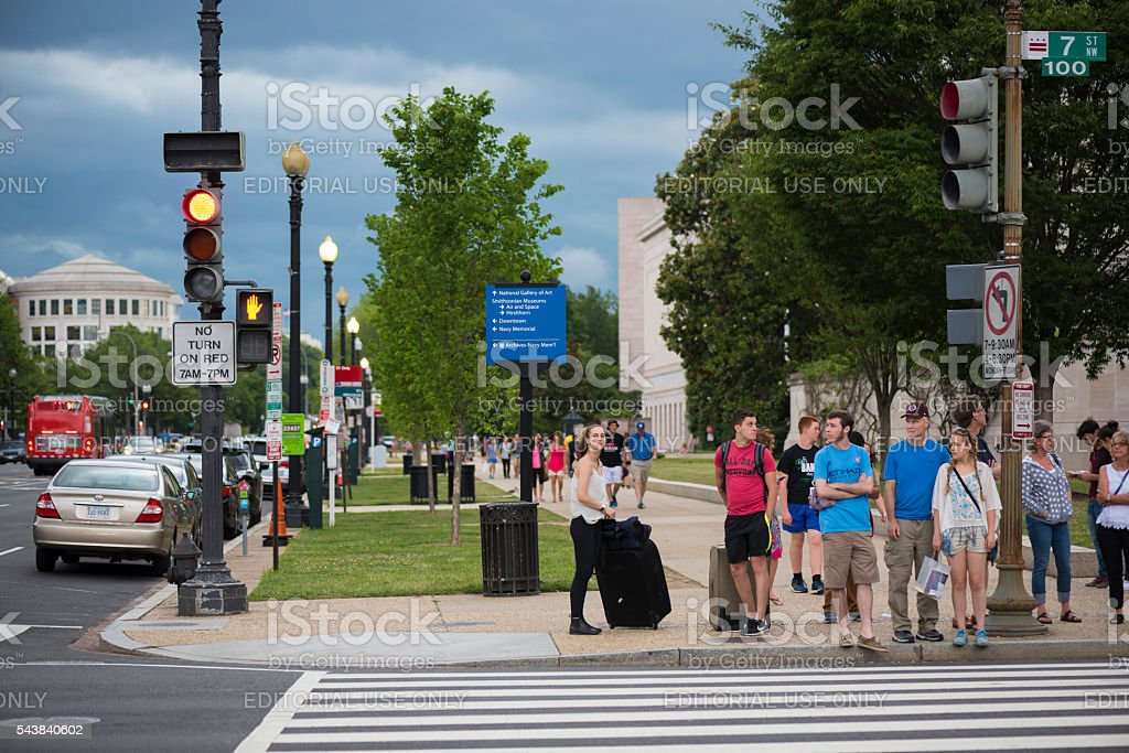Pedestrians waiting to cross street in Washington DC stock photo