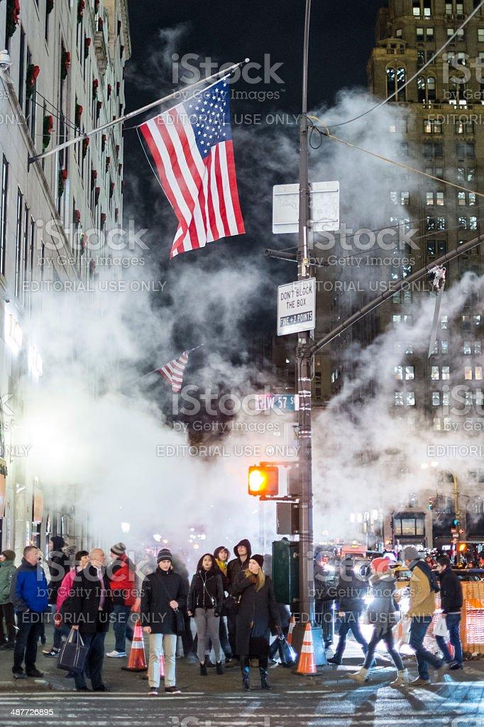 Pedestrians waiting to cross street stock photo