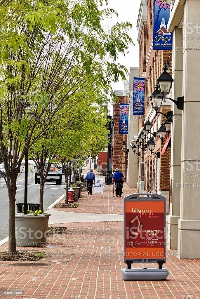 Pedestrians Walk Along Street in Old Town Fairfax, Virginia stock photo
