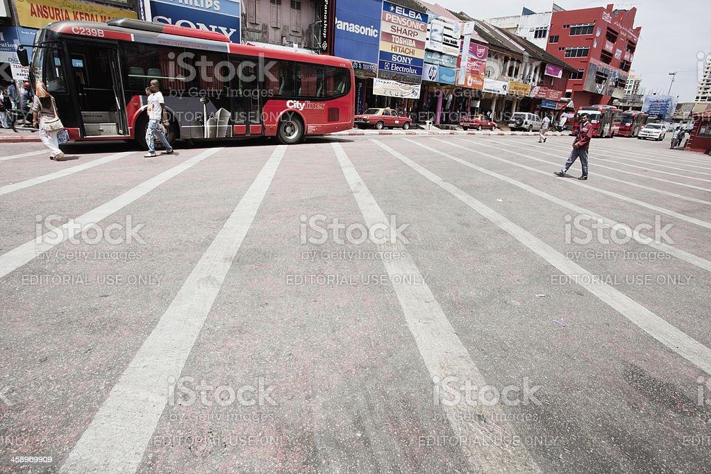 Pedestrians walk in Kota Bharu's. stock photo