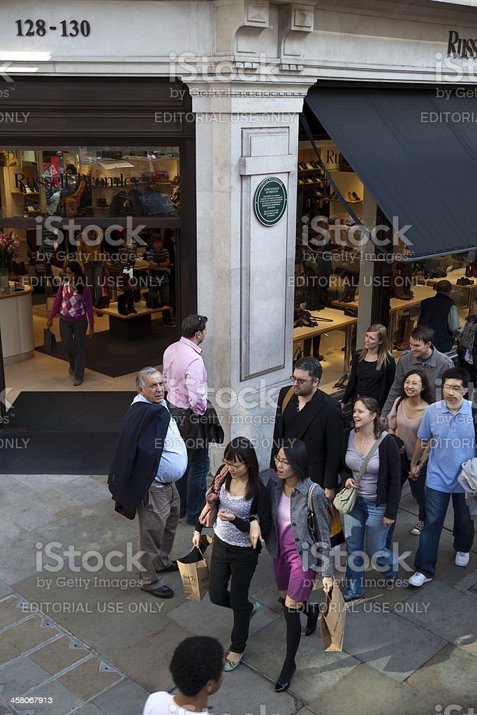 Pedestrians Walking in Front of a Fashion Store, London, UK royalty-free stock photo