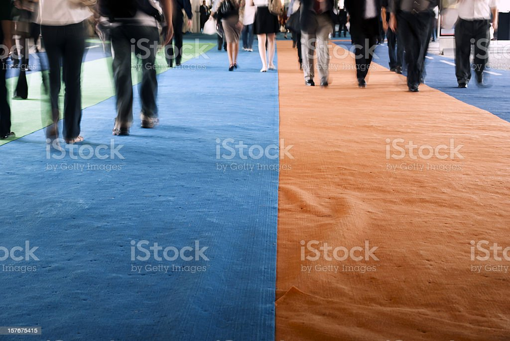 Pedestrians walking on a carpet stock photo