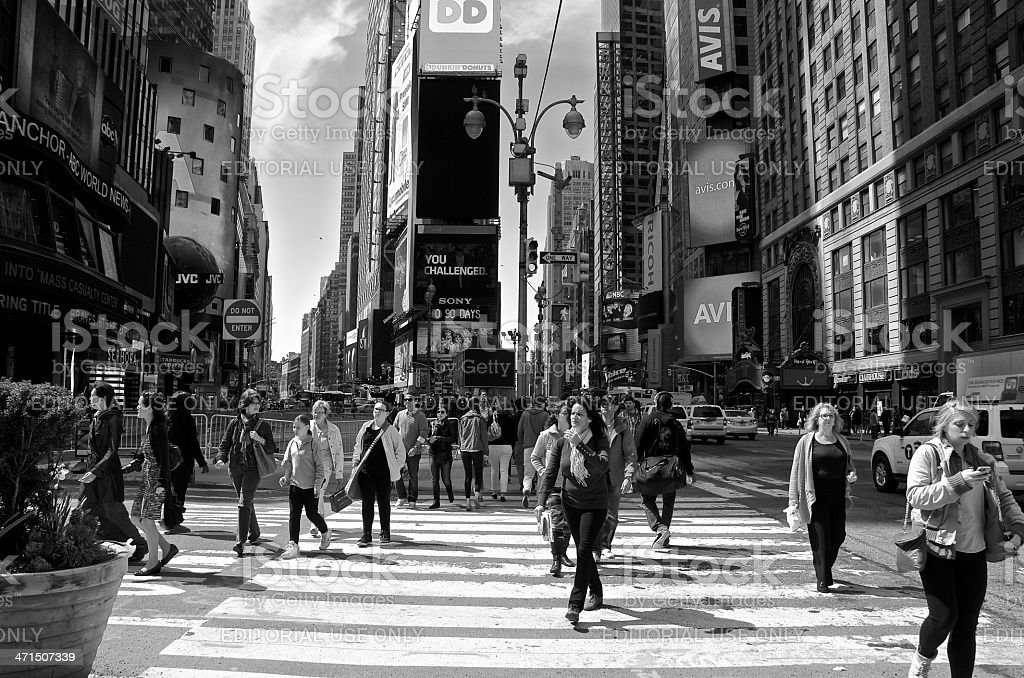 Pedestrians walking through Times Square , New York City royalty-free stock photo