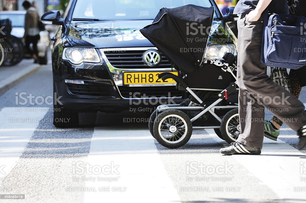 Pedestrians with child walking on zebra crossing in front-of car royalty-free stock photo