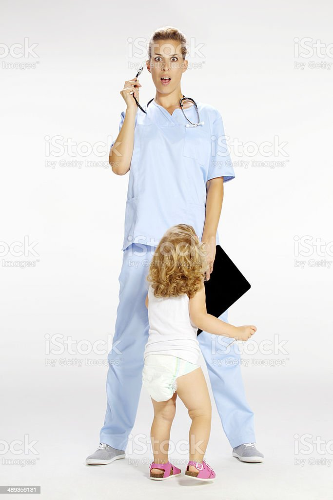 pediatric doctor exam little girl with  stethoscope royalty-free stock photo