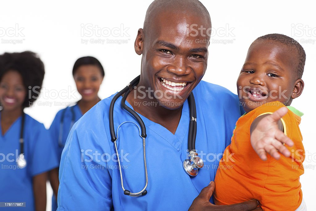 pediatric doctor playing with baby boy royalty-free stock photo