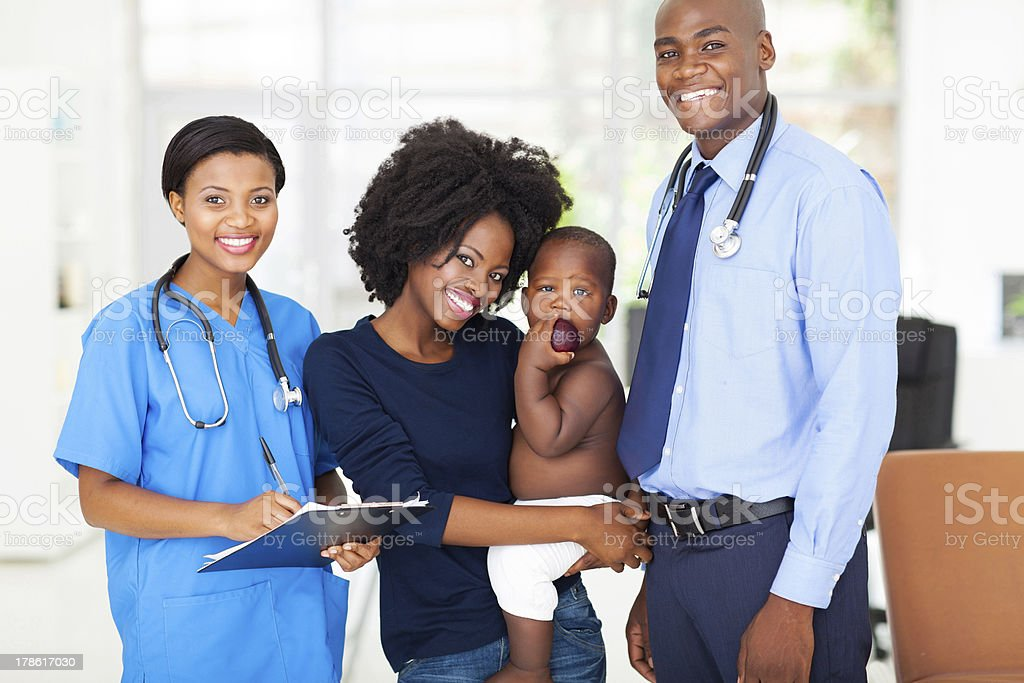 pediatric medical professionals with mother holding her baby royalty-free stock photo
