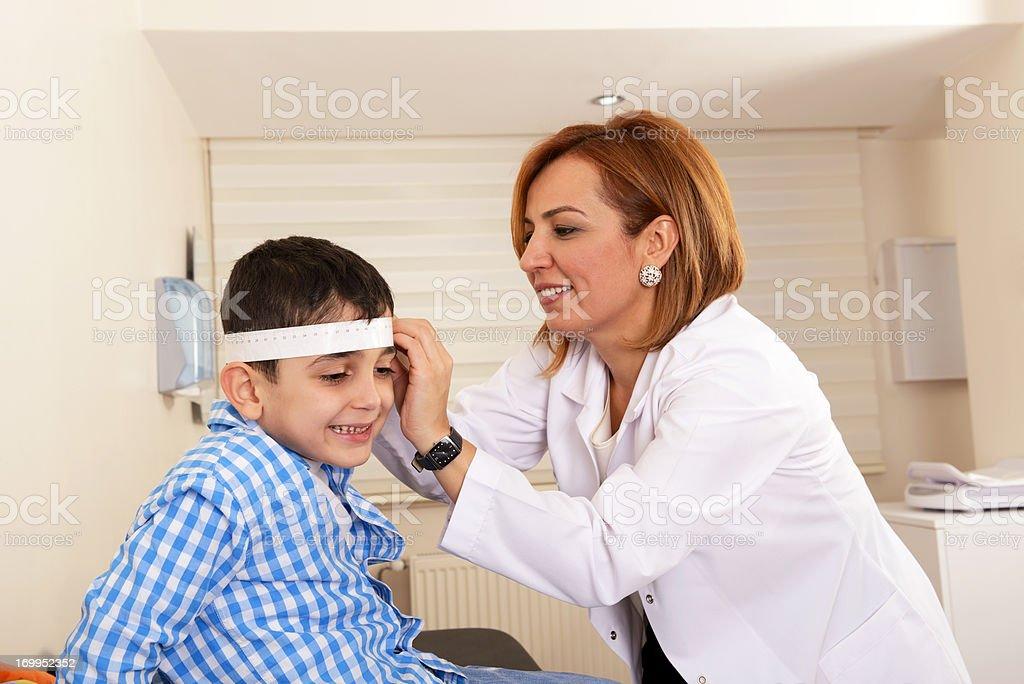 Pediatric Neurologist treats young patient stock photo