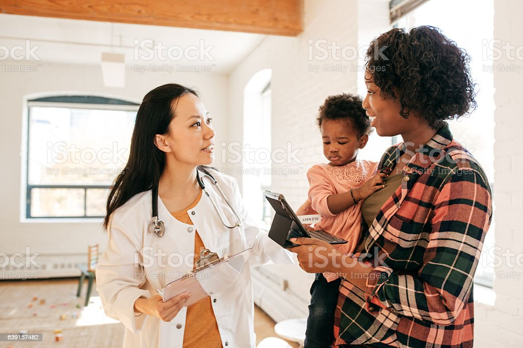 Pediatrician and toddler stock photo