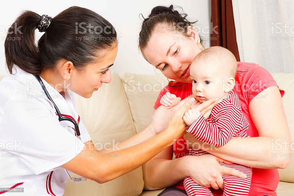 Pediatrician checking a baby royalty-free stock photo