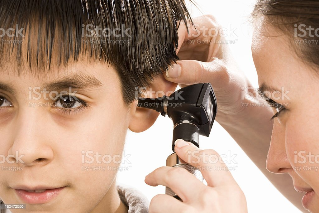 Pediatrician checking patient's Ears stock photo