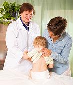 pediatrician doctor examining baby at clinic