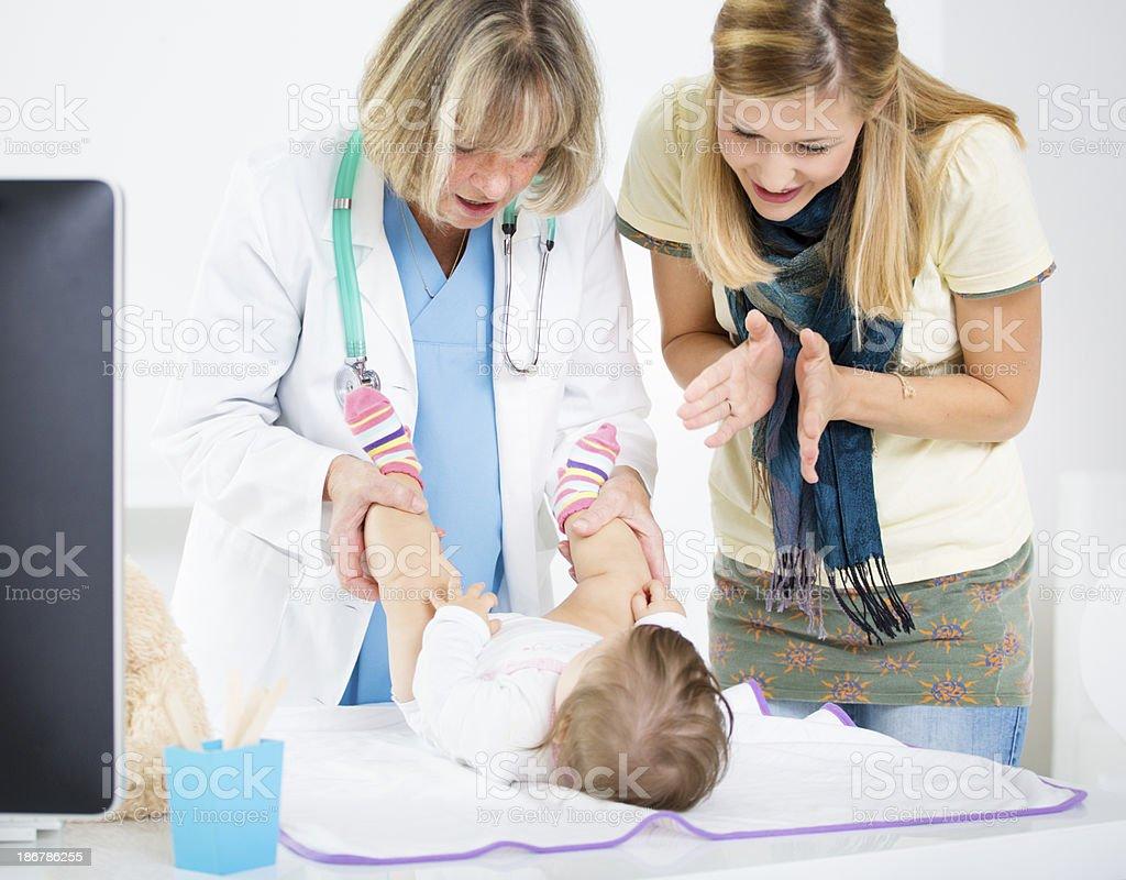 Pediatrician Doing An Infant Hip Exam. royalty-free stock photo