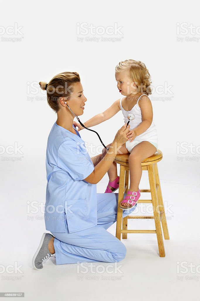 Pediatrician exam stock photo