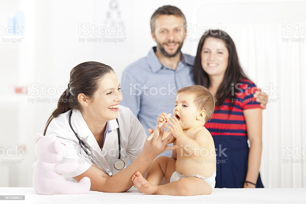 Pediatrician with baby patient royalty-free stock photo