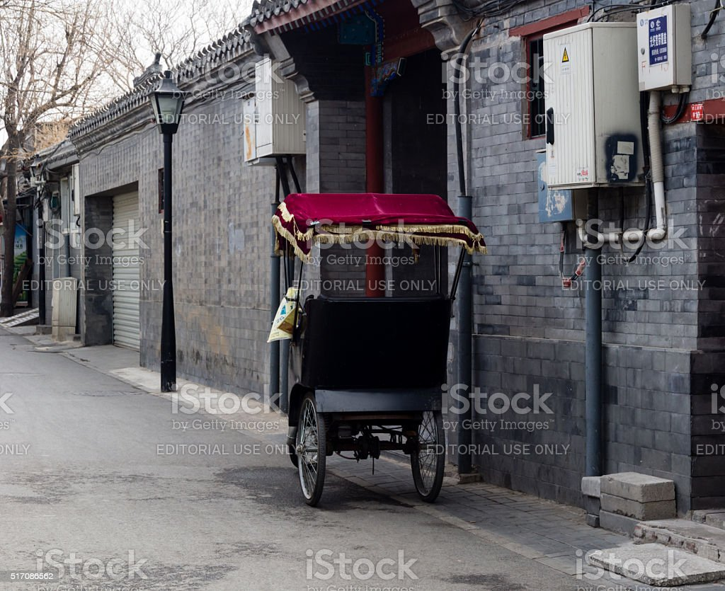 Pedicab parked on a quiet hutong street in old Beijing stock photo