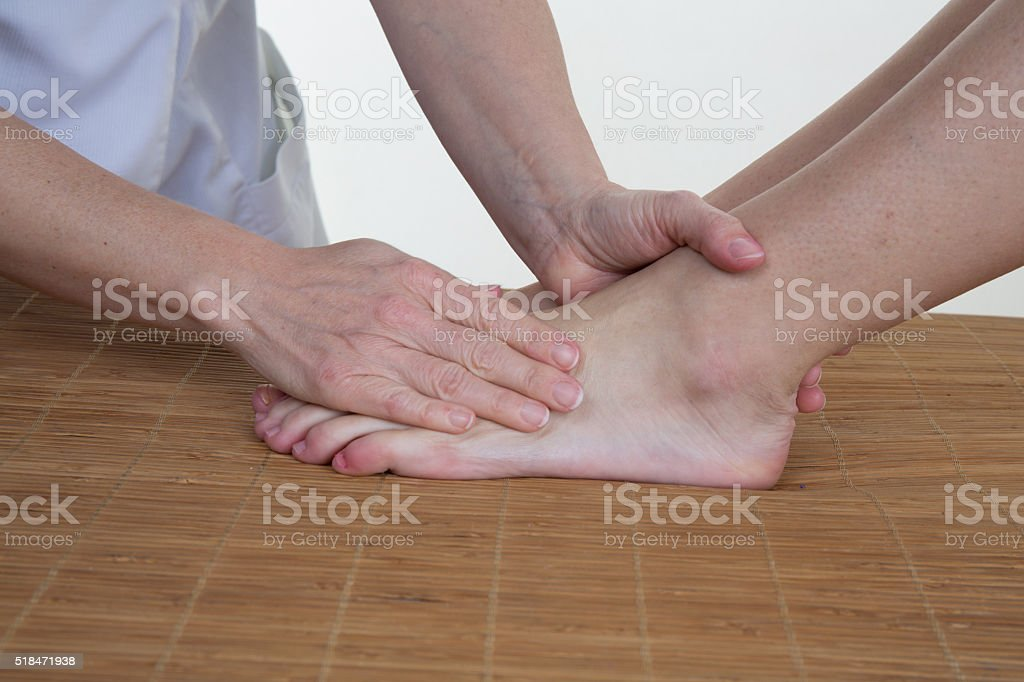 Pedicure and foot massage.Woman in a beauty salon for pedicure stock photo