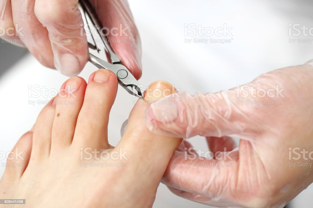 Pedicure, cutting skins. stock photo