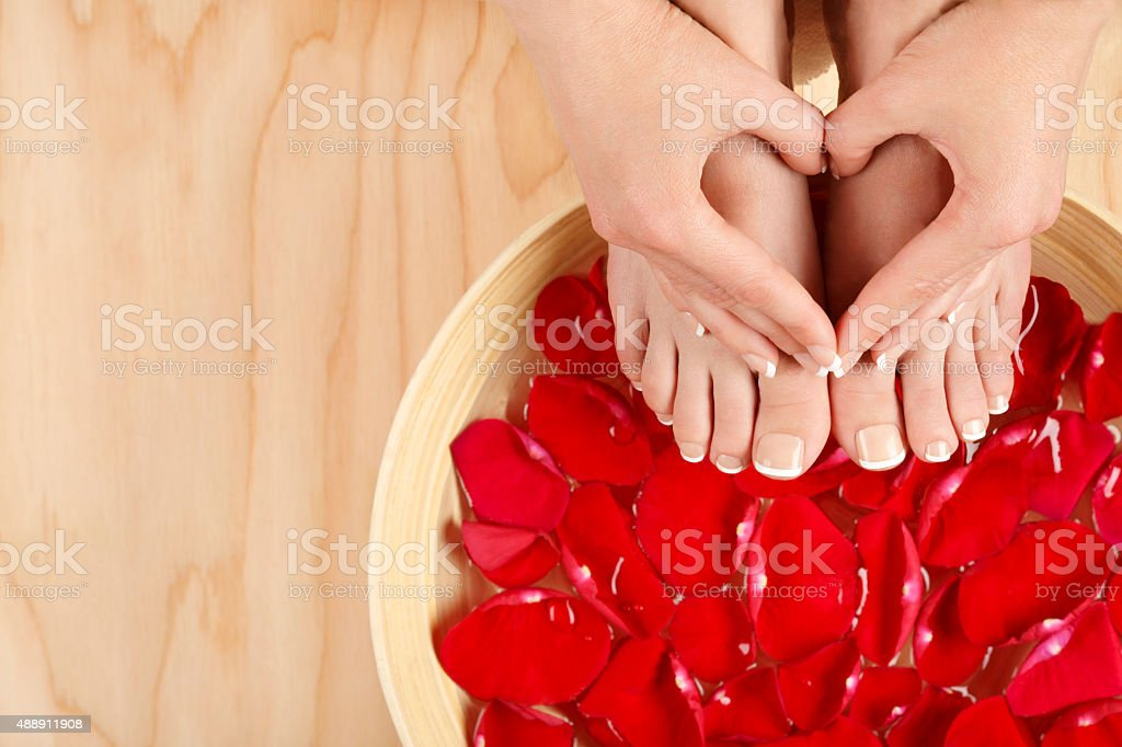 Pedicure Manicure Spa Treatment with Red Roses Wood Background royalty-free stock photo