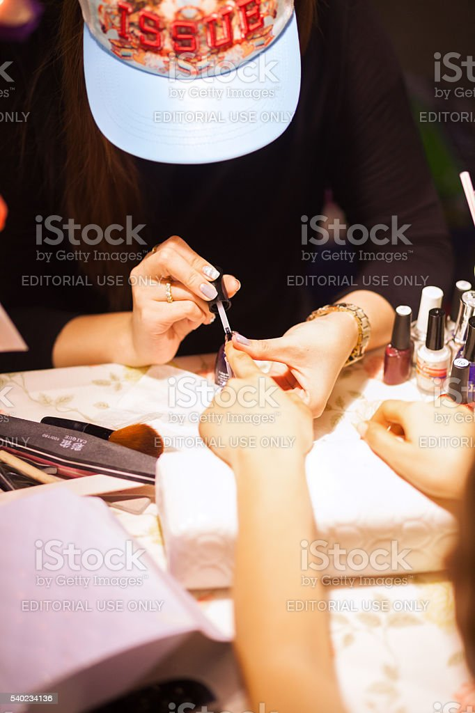 Pedicure on night market stock photo