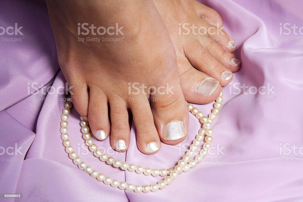 Pedicure with rose stock photo
