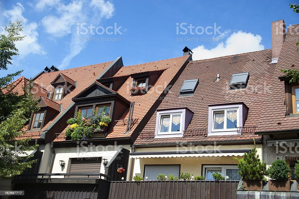 pediment with blue sky of private houses stock photo
