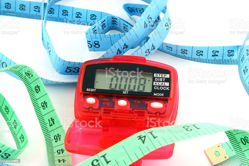 Pedometer with tape measures royalty-free stock photo