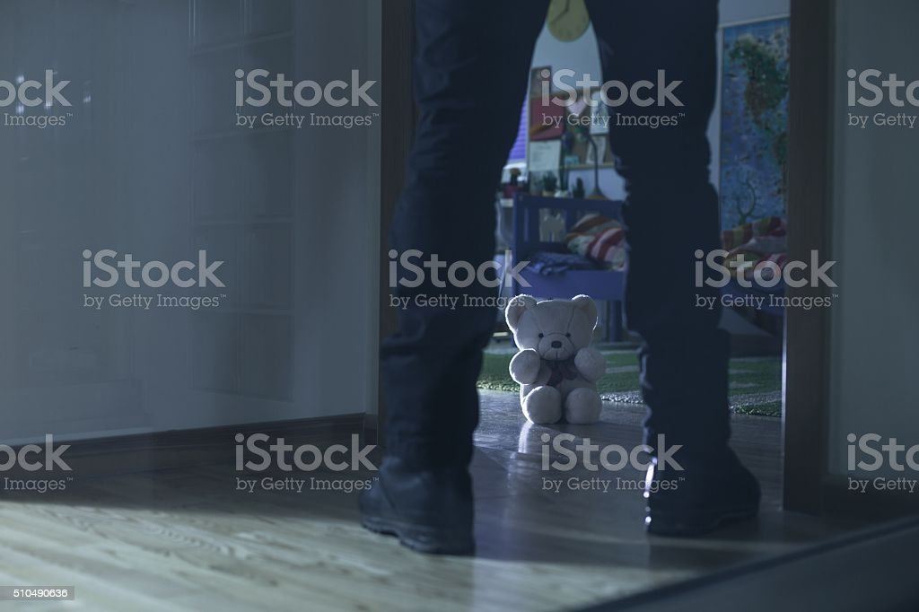 Pedophile standing at the entry stock photo