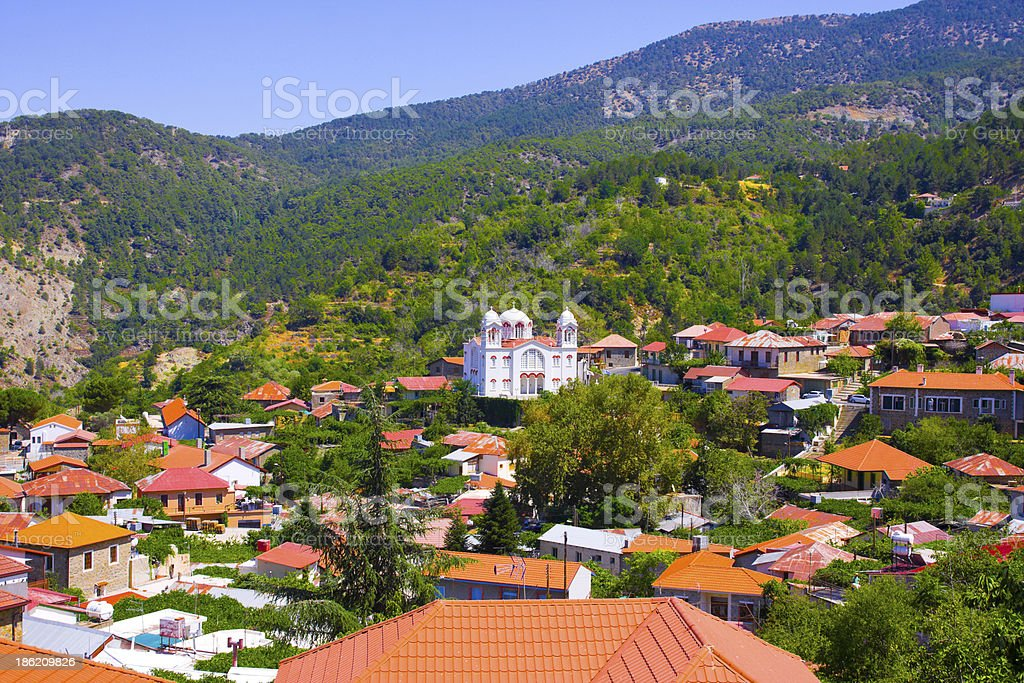 Pedoulas, Cyprus. Roofs, mountains and Big church of Holy Cross stock photo